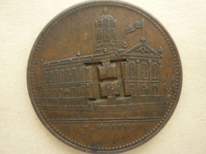 An example of the coin with the letter 'H' stamped on it