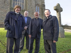 Local clergy in front of the old cross