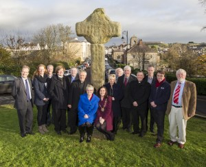 Politicans, museum staff and clergy, just prior to the removal of the old cross