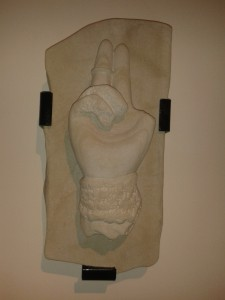Replica in sandstone of a medieval carving of St Patrick's hand by Claire Sampson