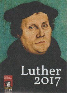 Martin Luther's portrait which comes with the figurine